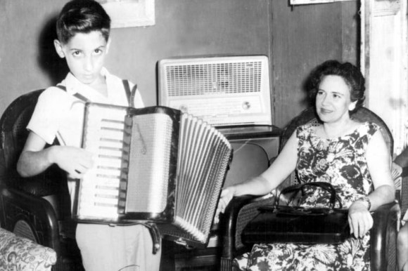 Emilio plays the accordion
